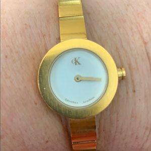 Calvin Klein skinny gold band watch